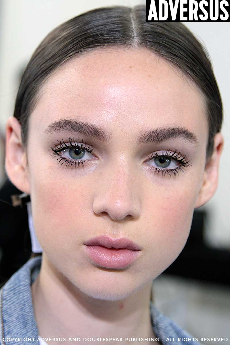 Makeup trends 2018. Glowy skin, beautiful curly lashes and natural eyebrows. Photo Charlotte Mesman Backstage aquilano.rimondi Summer 2018 Milan Fashion Week